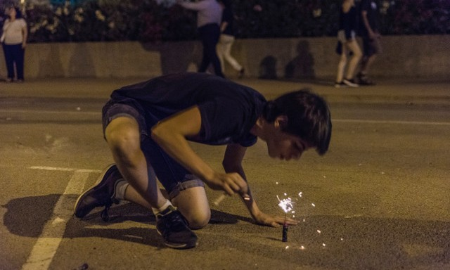 Boy exploding firecrackers